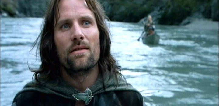 Aragorn in boat on river Anduin